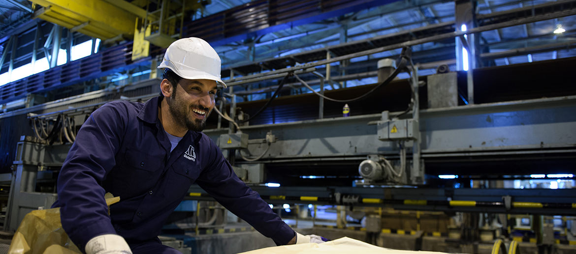 A happy worker inside of the Garmco factory