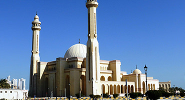 A large mosque with blue sky